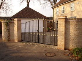 Arch Top Iron Driveway Gates. Illustrative picture to show materials and finish