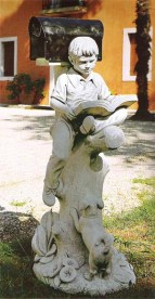 Boy sitting on a tree letter box statue