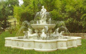 Giubileo is a large decorative water fountain with a Greek God statue to the centre