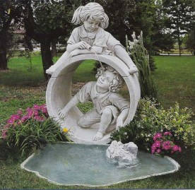 Laguna Copacabana is a boy and girl playing by a pond cement stone water feature