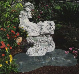 Laguna Costaricas is a girl sitting on rocks above a pool water feature statue