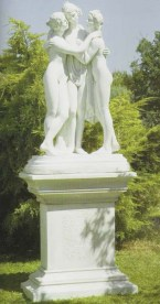 Girl - Woman sitting on a water font garden statue